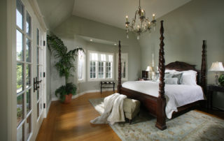 The spacious new master bedroom is serene in tones of green. The French doors offer a private entry to the back yard. A high ceiling &. Lovely chandelier adds elegance in this master suite. With hardwood floors throughout &. Large bay window this room is truly striking.