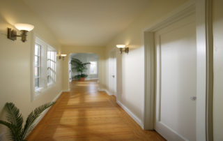 The entry to the master suite reveals a gorgeous sunlit hallway with doors leading to a walk-in closet, luxurious bathroom & an archway inviting yon into the fabulous new master bedroom.