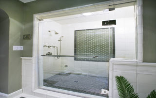 """This luxurious bathroom includes a 1/2"""" frameless glass enclosure with a vented transom for the full steam shower. Tire handcrafted Water Works tile was used on the walls &. Ceiling. The 1/2""""x 1/2"""" mosaic patterned floor was placed by hand. The polished nickel plumbing fixtures include a diverter that distributes water between a hand held spray &. a fixed shower head. Also in polished nickel, is the steam shower supply which is controlled by dual thermostats."""