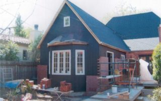 A new 50 year composition roof is now visible in its new black color, perfectly Contrasting the red brick. A false grid window was placed in the attic tor Exterior appeal. A true bay window with rich wood windows was the perfect Addition for this cottage home.