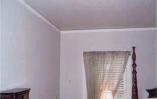 This wall of the existing master bedroom was removed & the creation of a new master suite began.