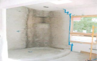 This custom mortar floated shower with radius walls & an elliptical arched curb are a superb start to this masterpiece. A vaulted ceiling makes this already large bathroom tremendously spacious.