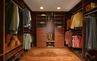This his/hers walk-in closet provides plenty of room to prevent crowding. Stain grade casework in this closet maintains the naturally rich theme throughout the house. The recessed lighting provides wonderful lighting above the engineered maple floor.