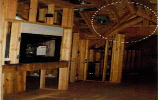 During photo of rough framing and wiring. Notice the energy efficient gas fireplace & true framed valley.