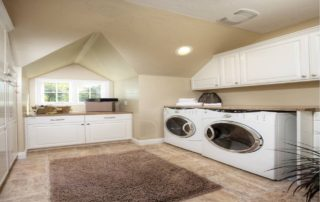 Built in cabinetry throughout this 2nd floor laundry room provides ample storage and counter surface. The vaulted dormer is home to a custom gift wrapping station. The front loading washer and dryer are built in for appearance but were selected for efficiency.