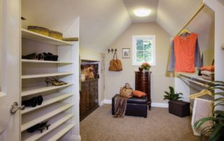 Pictured here is the wife's walk-in closet. Boasting great architecture, tons of natural light, plenty of shoe storage and a custom built niche for a previously owned antique dresser.