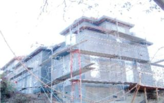 Four levels of scaffolding surrounding the new addition reveal the true mass of this project.